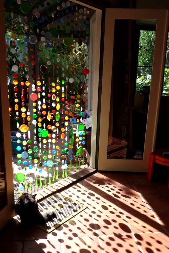 Bead Curtain made from plastic bottles - finally finished!! View from inside with morning light making shadows and reflected light spots on the floor. The cats think these are some sort of firefly / mouse to chase!