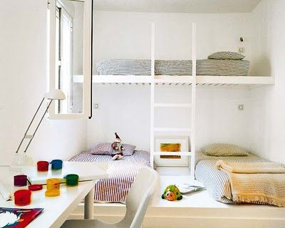 This is way too minimalist for me, but this is a good idea for putting 3 kids in one room.  Loft bed on top; two beds on bottom.  I'd put a nightstand, dresser, or bookshelf between the bottom two beds.
