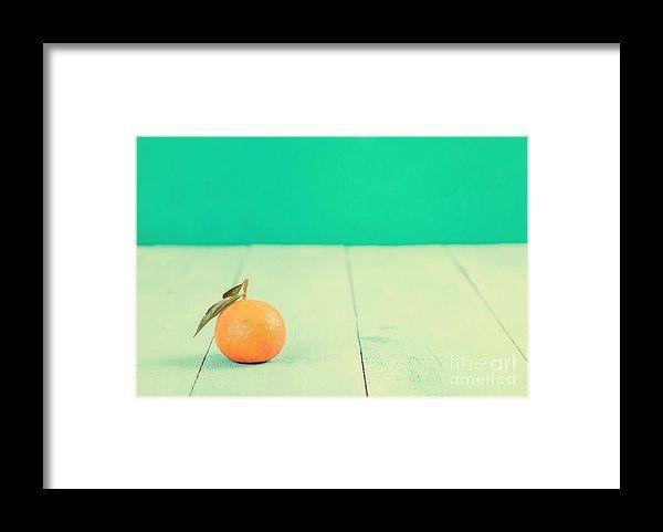 Fresh Tangerine On Blue Table Framed Print