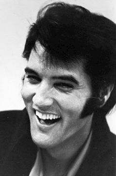 Elvis 'The King' Presley. LOVE his music! My fondest memory as a little girl is standing on my grandfather's shoes as he danced through the kitchen @ Christmastime while listening to 'The King' belt those lungs out. R.I.P. Pappy <3