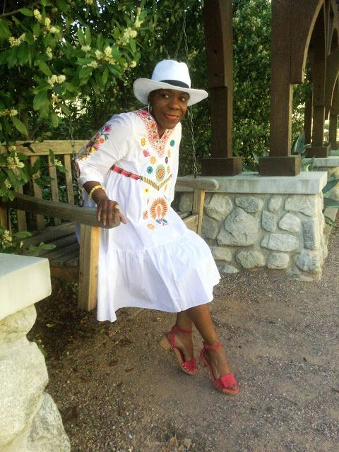My latest style story is called La Bohemian Nueva. Wearing an embroidered, white festival dress, white straw hat and red Nine West Sandals at So What to Twenty!