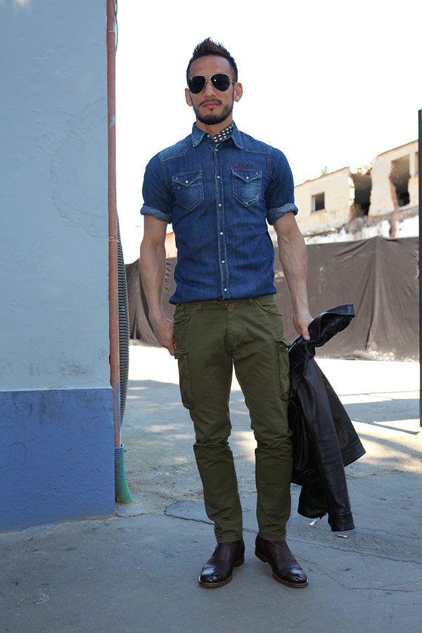 Shop this look for $174:  http://lookastic.com/men/looks/denim-shirt-and-bomber-jacket-and-cargo-pants-and-brogues-and-scarf/1359  — Navy Denim Shirt  — Black Leather Bomber Jacket  — Olive Cargo Pants  — Burgundy Leather Brogues  — Black and White Polka Dot Silk Scarf