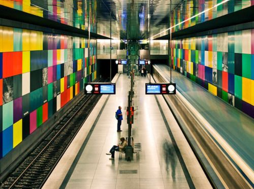 This subway station is the first of the new artistic station generation. Its concept was created within QUIVID, the 'art on buildings program' of the Bavarian capital Munich. The artist Franz Ackermann created here 'The Great Journey' from 400 metal panels - two huge colour screen walls. Photos, paintings, postcards and maps are integrated.