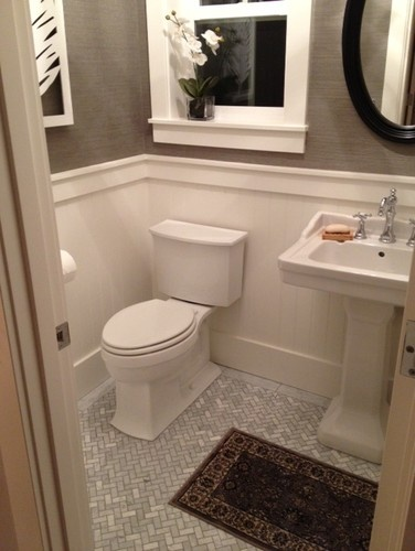 I know it's a window in the photo, but  could put an alcove above the toilet.