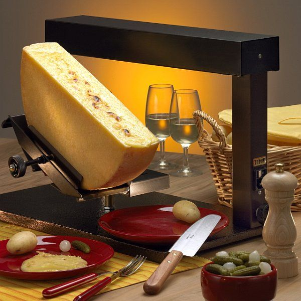 A raclette heater is often used in restaurants or by vendors, but you can make your own raclette meal at home with a raclette grill. #raclette-recipes #tabletop-cooking #the-tabletop-cook