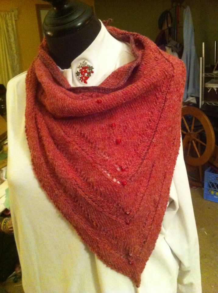 Small stitches add elegance to this wool triangle shawl. Don't let the size fool you that the warmth factor is awesome