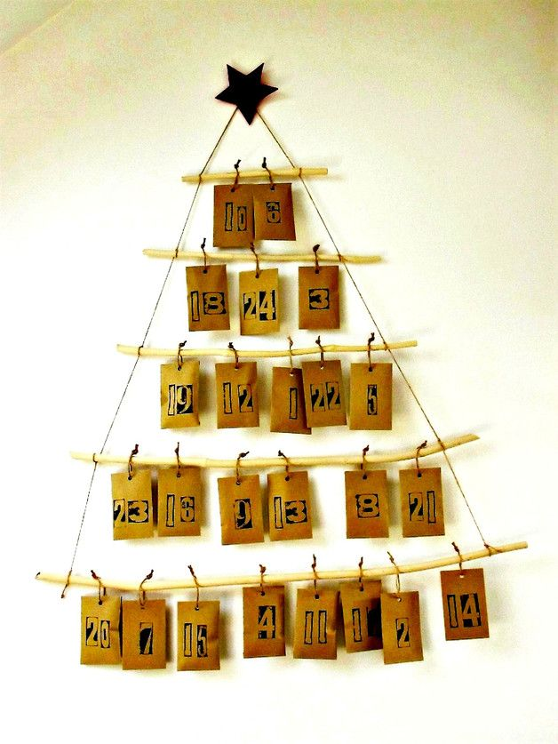 The perfect way to countdown to Christmas. The do-it-yourself advent calendar kit includes five polished elder tree branches (from my garden in North London), twenty four hand printed kraft...