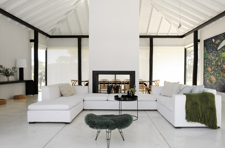 The fireplace, made of black metal, was designed by the architect and heats both the living and dining area.