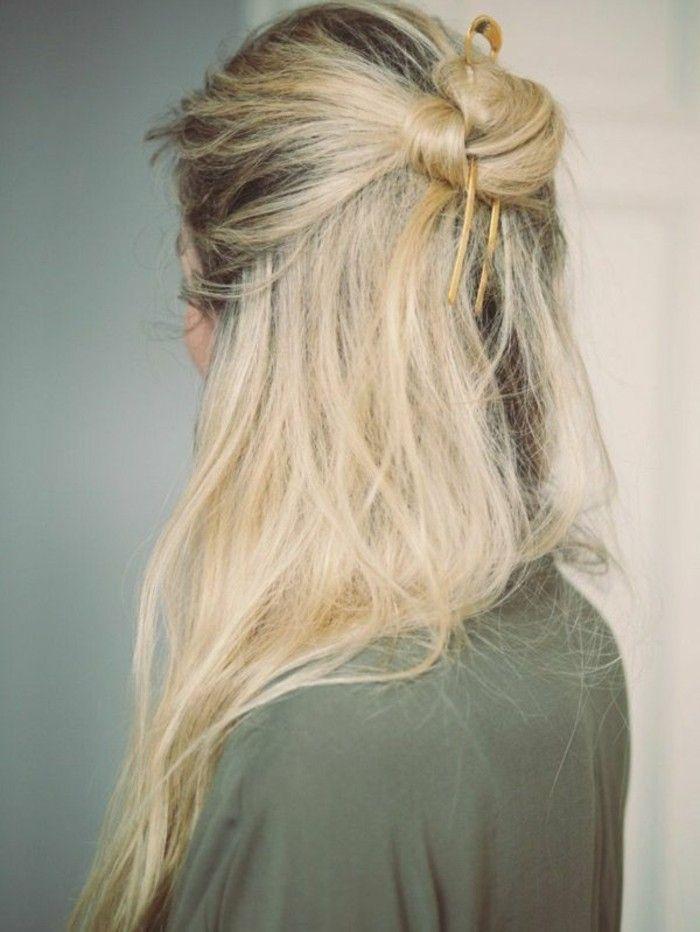 color-caoba-mujer-con-pelo-largo-tinte-rubio-pelo-recogido-en-moño
