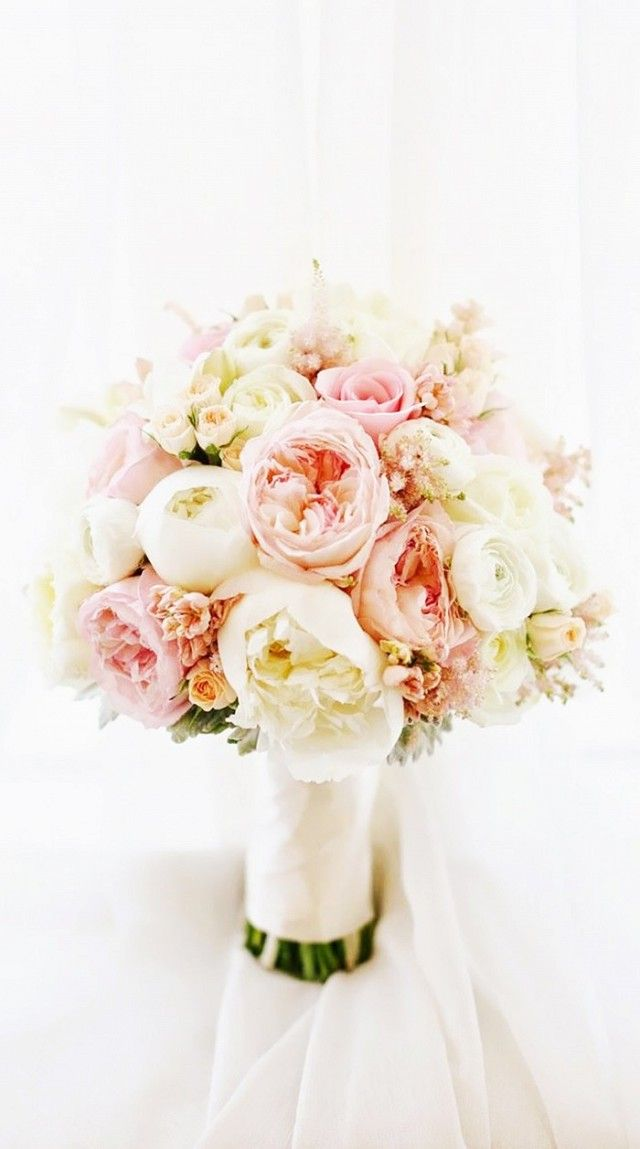 Blush pink peonies in a classic wedding bouquet