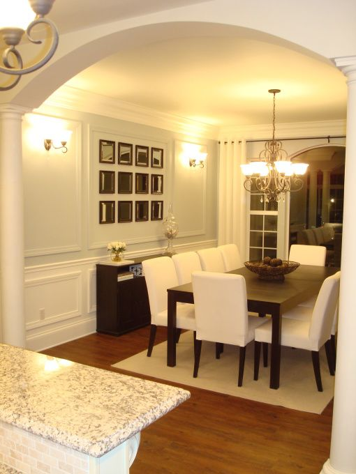 not design, but layout, kitchen view to dining room, to left of dining room wall,- archway into lounge