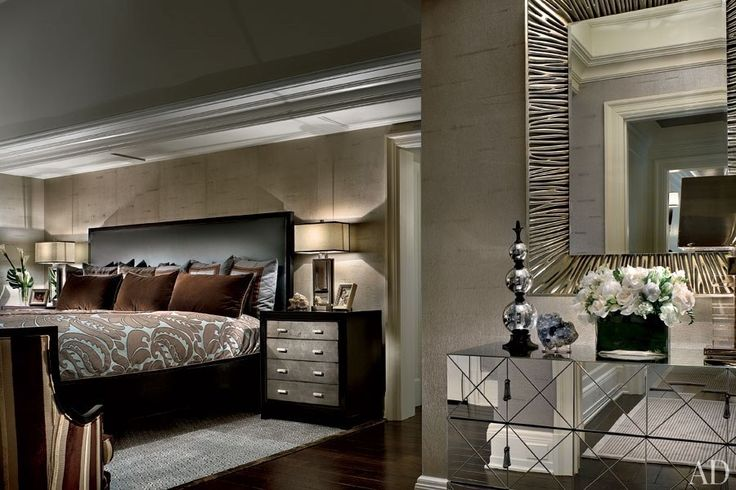 An oversize bed devised by designer Martin P. Mitchell anchors the master bedroom of New York Yankees pitcher C. C. Sabathia in his Alpine, New Jersey, home.