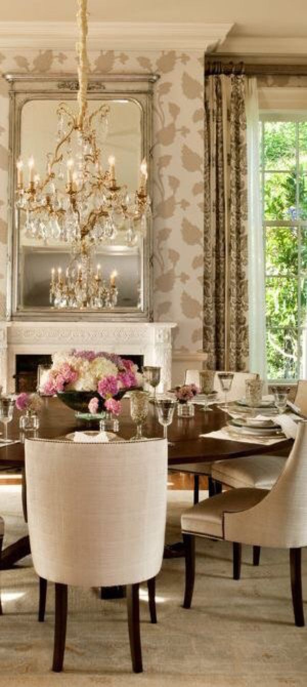 Elegant Dining Room With Neutral Color Scheme Wallpaper Draperies And Chandelier Defines Adds Interest To This Space