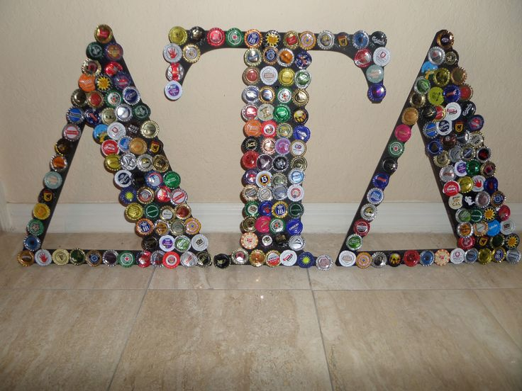 Delta Tau Delta Bottle Cap Art... I have enough collected to make this for my boyfriend.