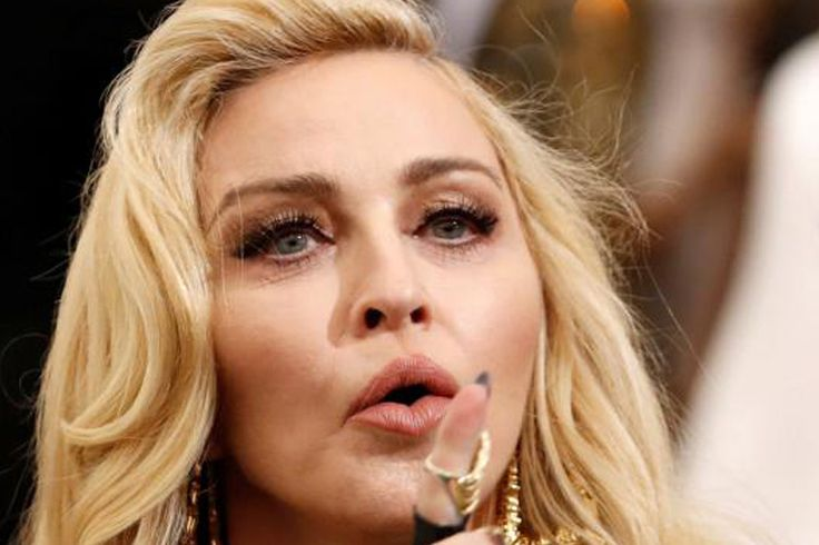 Madonna asked a judge Tuesday to block an auction of memorabilia including a breakup letter from rapper Tupac Shakur, saying the intimate items...