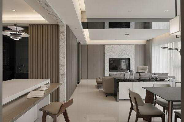 The marble in the kitchen can also be found along the back wall of the living area, serving as a luxe anchor for the TV. A mirrored ceiling adds space and creates a sense of height.
