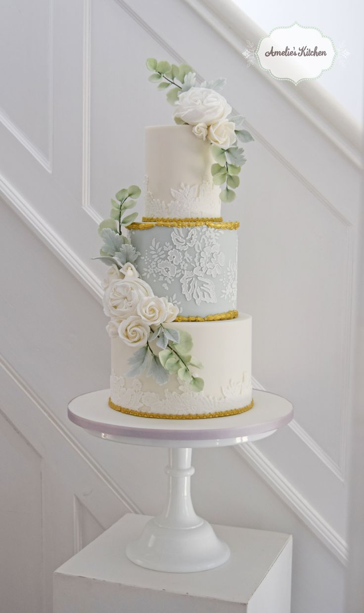 Pale blue and gold lace cake design for a wedding at Gosfield Hall in Essex with david austin sugar roses