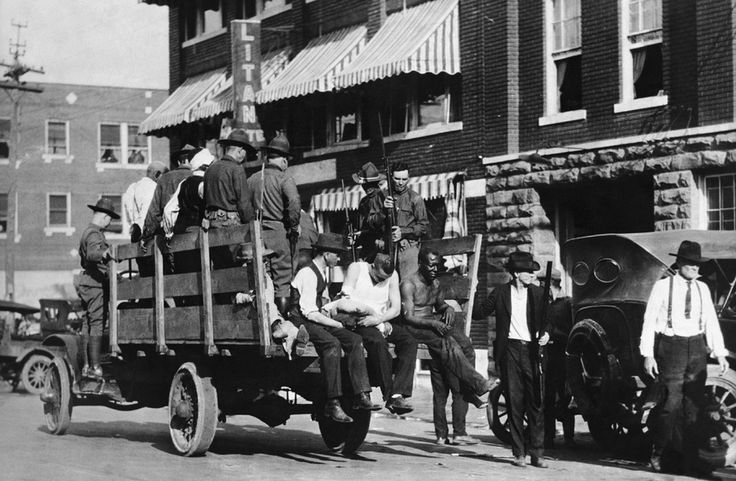 "The Case for Reparations - The Atlantic In the spring of 1921, a white mob leveled ""Black Wall Street"" in Tulsa, Oklahoma. Here, wounded prisoners ride in an Army truck during the martial law imposed by the Oklahoma governor in response to the race riot. (Hulton-Deutsch Collection/Corbis)"