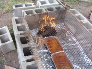 How to use cinderblocks to build a temporary back-yard barbecue pit to smoke a whole hog - for that BIG summer party  :-)  Inexpensive & super-simple to build & take down:  see this link http://cowgirlscountry.blogspot.com/2007/03/cooking-whole-hog-on-cinder-block-pit_19.html