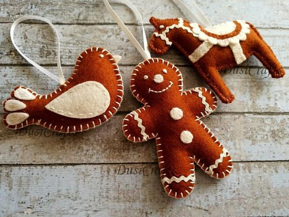 Wool Felt gingerbread Christmas ornaments This listing is for set of 3 ornaments - smaller gingerbread man - horse - bird Size of gingerbread man is 8 x 6 cm without the hanging loop Size of bird is about 5 x 7 cm ( 2 x 2 3/4 inches) Size of horse is 7.5 x 8 cm Handmade from best