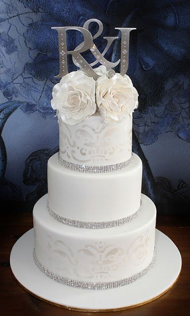 Wedding Cake I think you might like this style because it uses silver trim and the initials on top are nice. Not formal but nice.