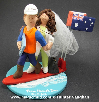 Surfs up for this wild Australian groom!!!l....he's got his matrimonial hardhat on as his doctor bride clings to him for her dear newlywedded life..... it can be an exhilarating ride on these big waves of nupital events and emotions!!!.....  their respective native lands flags are flapping wildly in the wind behind them....$235  #surfer#canada#australia#flags#wedding #cake #toppers #custom #personalized #Groom #bride #anniversary #birthday#wedding_cake_toppers#cake_toppers#figurine#gift