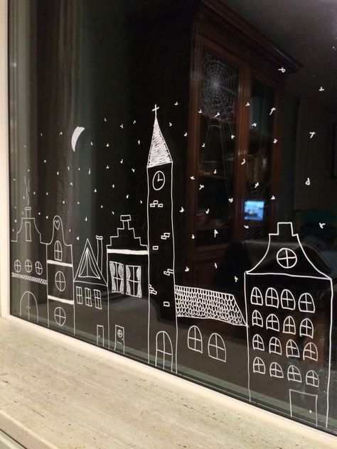 Winter scene on window with chalk marker