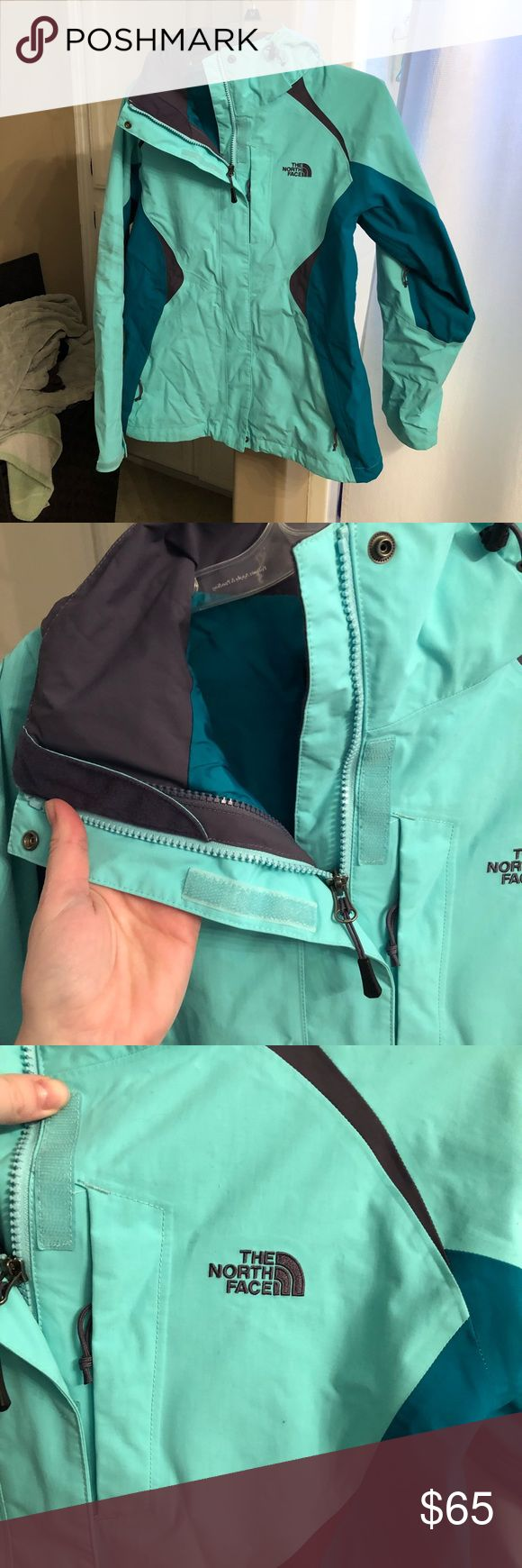 Womens North Face coat Womens size M North Face windbreaker coat with detachable hood Inside zippers to zip on a North Face fleece (see photos) Teal & dark purple color Long in the back & sleeves-good for snow One year old, worn once North Face Jackets & Coats