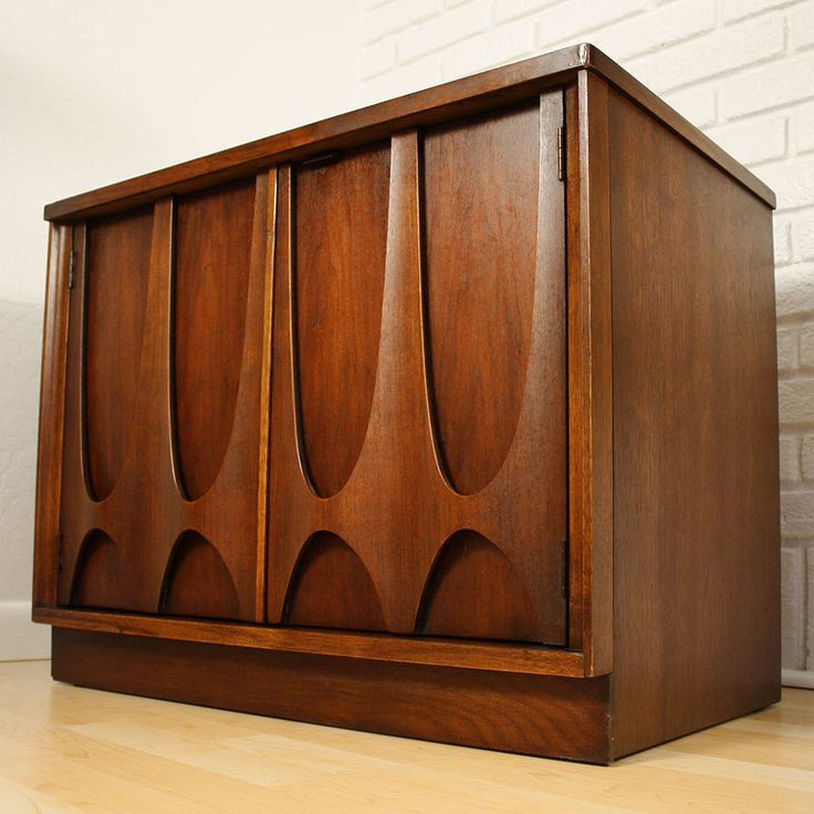 Mid century modern Broyhill Brasilia cabinet. That's a bitchin'ly cool treatment on the door fronts. Brasilia brings Niemeier to mind, does it not?