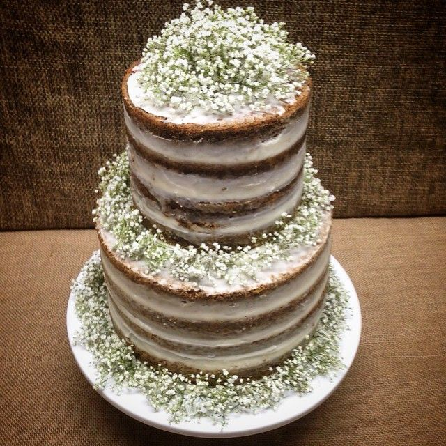 Lovely Naked Tiered Cake With Babies Breaths Decor