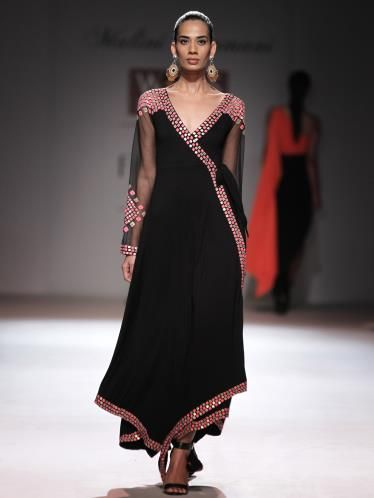 A model walks the ramp for Malini Ramani at the Wills Lifestyle India Fashion Week (WIFW) Spring-Summer 2014, held in Delhi