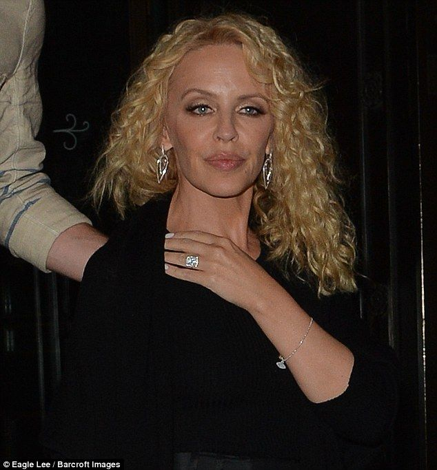 Bling bling! The Spinning Around hitmaker proudly flashed her dazzling engagement ring, which she complemented with some silver drop earrings and a delicate silver bracelet