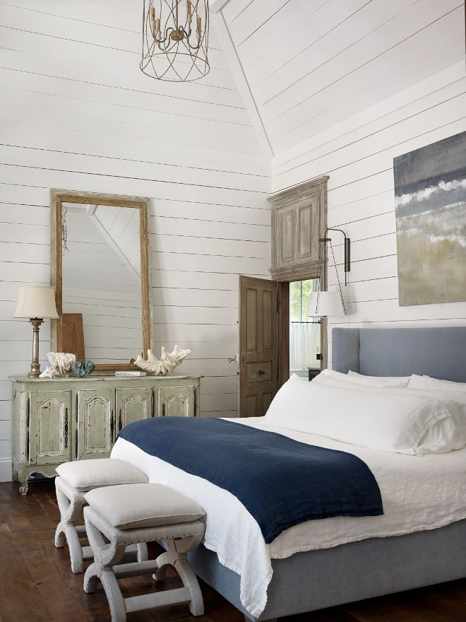 Shiplap bathroom paint color and decor. Shiplap wall and trim paint color is Pratt and Lambert Seed Pearl. The master bedroom features a beautiful Mitchell Gold upholstered bed in velvet. Lighting is from Urban Electric Co. #shiplap #Bedroom #Bedroompaintcolor #Bedroomdecor #Bed Interiors by Courtney Dickey of TS Adams Studio