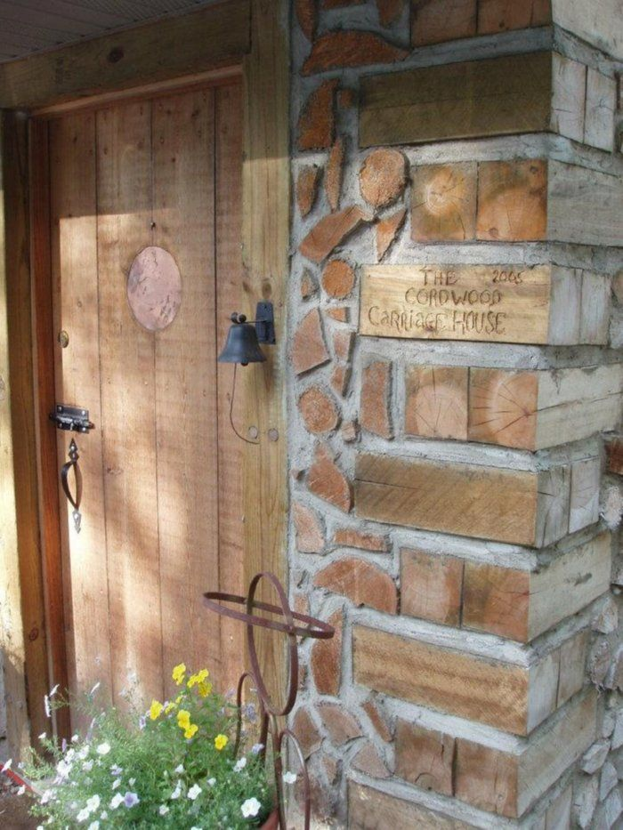 cordwood construction: door handle and latch! look at construction of door except round with a round peep hole