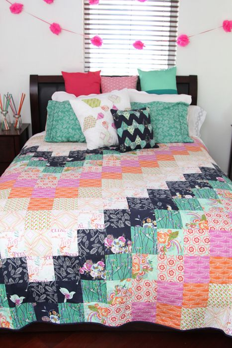 Vibrant colors on this beautiful quilt. Make it yourself! #ArtGalleryFabrics #Sew #Stitch #Thread #Kit #DIY #Design #Craft #HowTo #Makeit #Quilt #Fashion