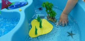 This tropical island water table is great for some fun small world play. Uses plastic toys, water beads, and craft foam.