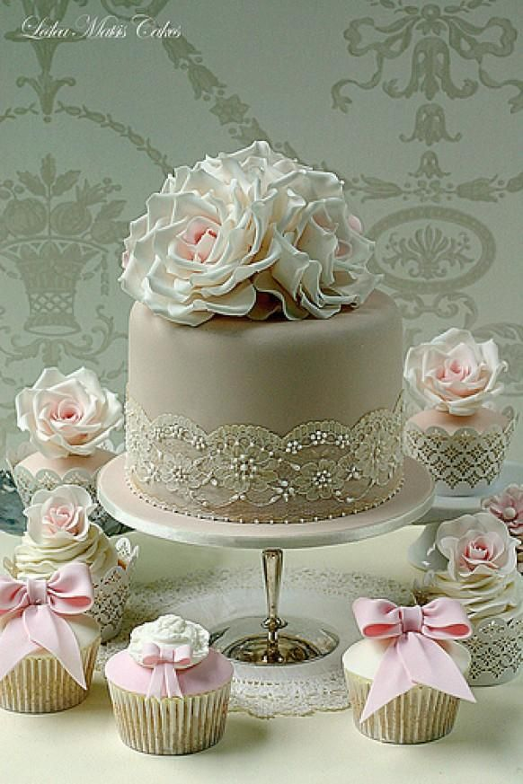 Pink roses with overpiped lace with 50 matching cupcakes. Wedding is in Queenstown :-)