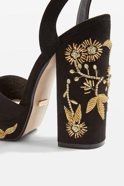 Black platform sandals with embellished detail on the heel.