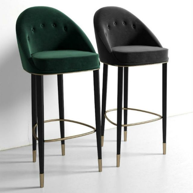 10 Sophisticated Upholstered Bar Stools That You Will Want To Have   Bar Chairs. Modern Chairs. Restaurant Interior. #restaurantinteriors #barchair #barstool Read more: https://www.brabbu.com/en/inspiration-and-ideas/world-travel/sophisticated-upholstered-bar-stools-want