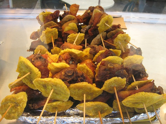 Pinchos, Puertorican food :) - Pork skewers with tostones (green plantain). Brushed with homemade bbq sauce.