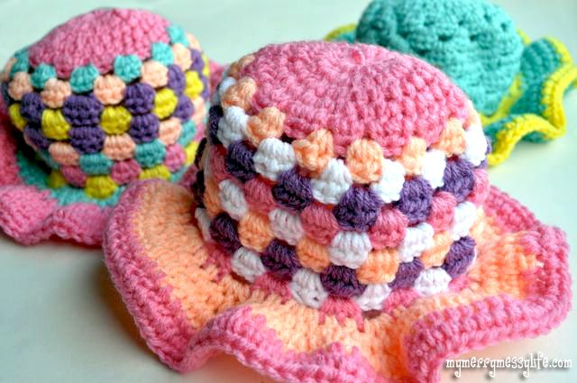 Free Crochet Sun hat Pattern. - I like the green one in the back!