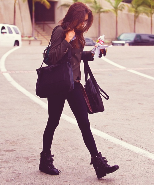 I would totally rock Nina Dobrev's look! Looks comfy and perfect for traveling! Love the boots!  <33