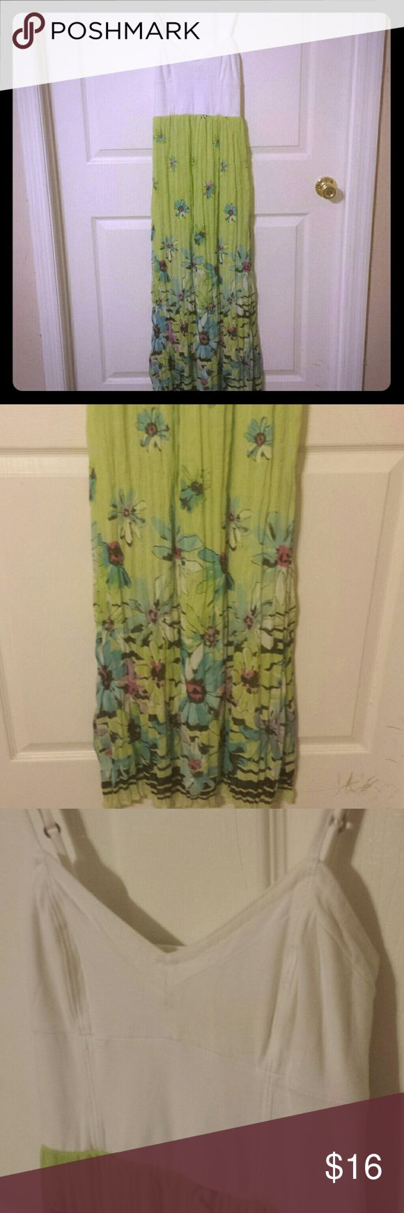 Maxi Dress Aeropostale, size small, maxi dress. Spaghetti straps. White top, green, floral skirt. Back stretches. Some slight signs of wash wear on the top portion. Aeropostale Dresses Maxi