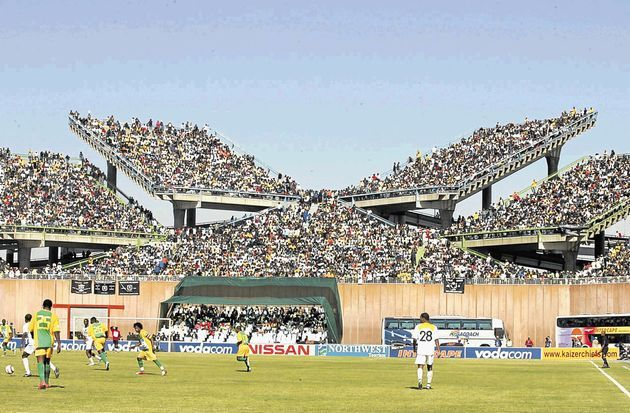 Mmabatho Stadium - South Africa  Constructed by a Russian company in 1989 Mmabatho goes straight into the history books for having the most sides to a football stadium.  With eight different sides the stadium tries to incorporate an equal viewing angle to every spectator - instead it gives half the 59,000 spectators a twisted neck and the accolade of ugliest stadium in the list.