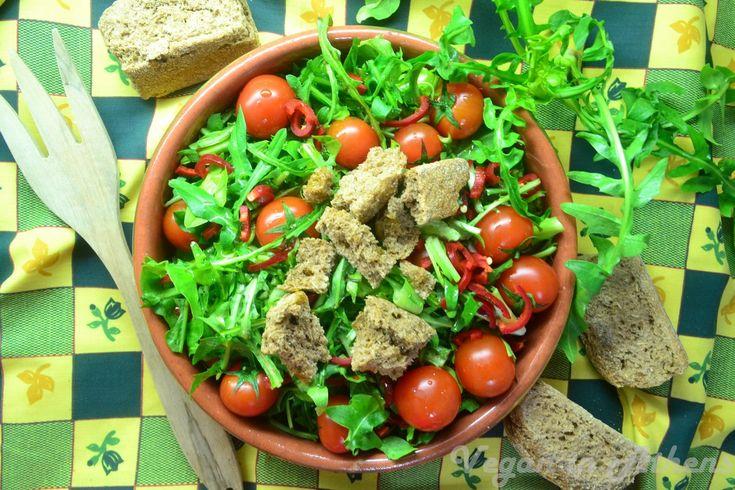 Stamnagathi, cherry tomatoes, traditional Cretan barley rusk and vinegret salad