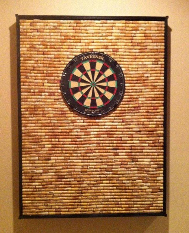 Protect Your Wall from Stray Darts with This DIY Dartboard Cabinet Made of Wine Corks « MacGyverisms such a smart way to save your walls!