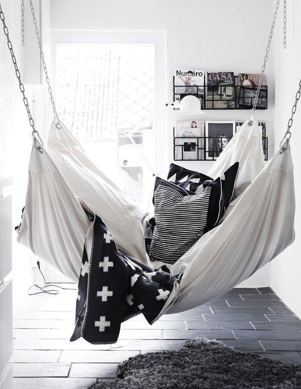 Pia Wallen Blanket Hammock, via Remodelista | indoor hammock | indoor swing | black and white home decor | cozy space | shag rug | floating bookshelves | reading corner | suspended seat |