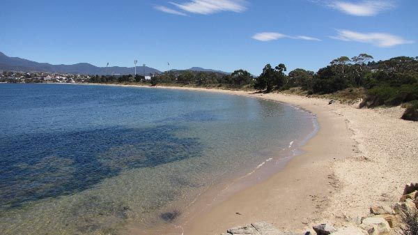 Bellerive Beach on the Eastern Shore of Hobart, with Blundstone Arena in the background. Article for Think Tasmania.