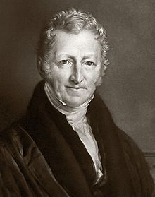 Reverend Thomas Robert Malthus (1766 – 1834) was an English cleric & scholar, influential in the fields of political economy & demography. He became widely known for his theories about change in population. His Essay on the Principle of Population observed that sooner or later population will be checked by famine and disease, leading to what is known as a Malthusian catastrophe.