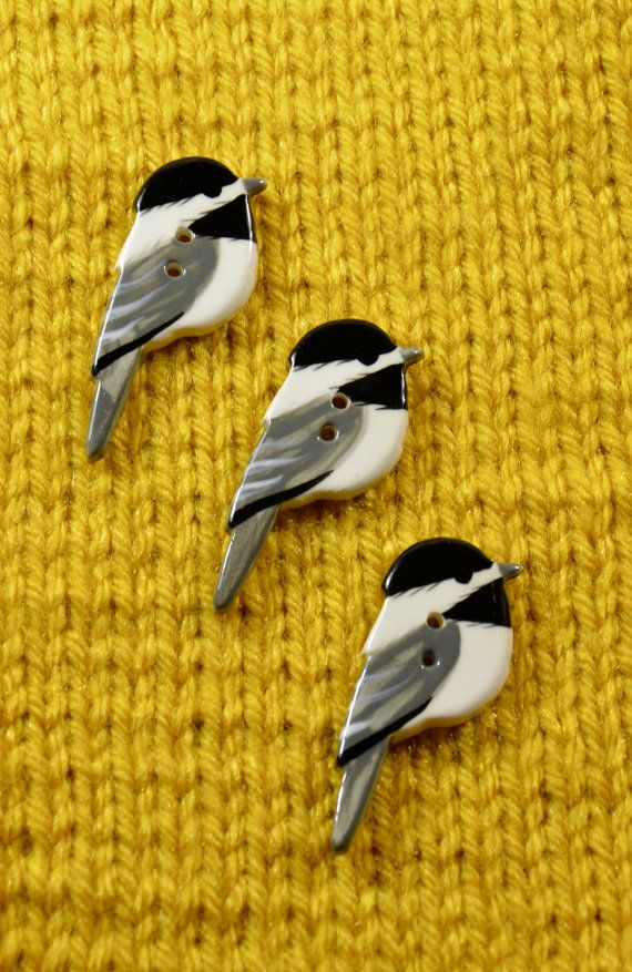 Hand -painted Ceramic Chickadee Buttons, delightful wee birds to add to your knitwear. By Debra Rutherford